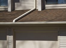White LeafGuard gutter on house